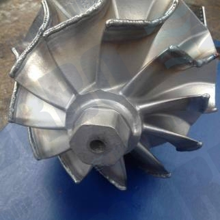 Repaired radial turbine blade
