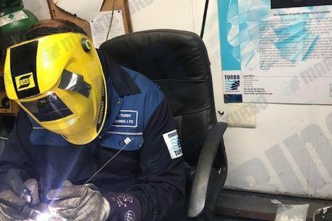 Marine Turbo Employee Repairing Parts