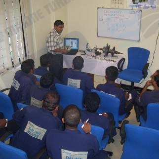 India Mumbai turbocharger training facility where senior engineers discuss with junior apprentices correct measurement techniques and problem service encounters with a mentoring approach