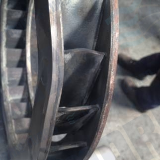 Radial nozzle ring bent blades before repair. Subsequenty refurbished to manufacturer's specification with 12 months warranty