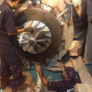 ABB TPL 77 B12 Marine Turbo service team installing after standard maintenance