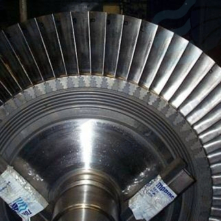 Mitsui MAN NA 48 57 70 weld repair wheel hub by specialist welding after machining and refitted with reconditioned turbine blades